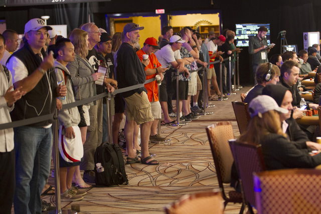 Spectators watch as pokers players compete during Day 4 of the Main Event of the World Series of Poker at the Rio Convention Center in Las Vegas on Friday, July 15, 2016. Richard Brian/Las Vegas R ...