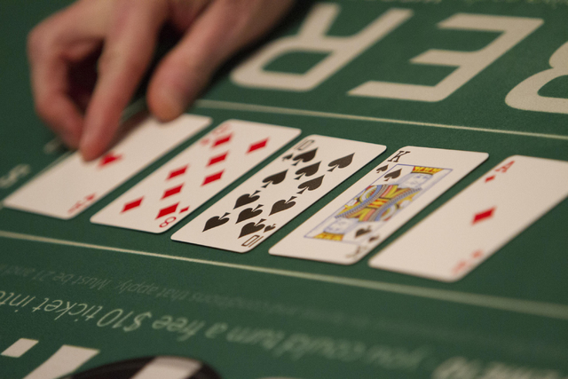 Cards are seen on a poker table during Day 4 of the Main Event of the World Series of Poker at the Rio Convention Center in Las Vegas on Friday, July 15, 2016. Richard Brian/Las Vegas Review-Journ ...