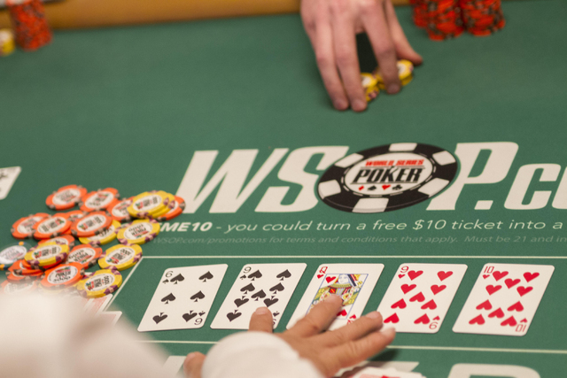 A dealer shows some cards during Day 4 of the Main Event of the World Series of Poker at the Rio Convention Center in Las Vegas on Friday, July 15, 2016. Richard Brian/Las Vegas Review-Journal Fol ...