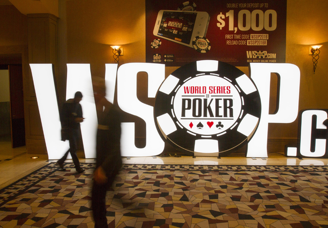 People walk past a WSOP sign during Day 4 of the Main Event of the World Series of Poker at the Rio Convention Center in Las Vegas on Friday, July 15, 2016. Richard Brian/Las Vegas Review-Journal  ...
