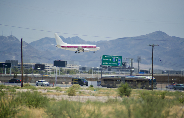 An aircraft is seen coming in for a landing from near the proposed site of a stadium near Tropicana Avenue and Koval Lane on Friday, July 1, 2016. Southwest has sent a letter to local officials re ...
