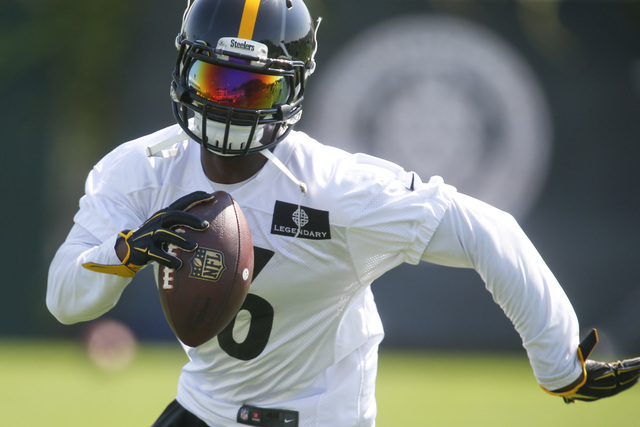 Steelers running back Le'Veon Bell carries the ball during NFL football practice in Pittsburgh on May 24, 2016. Bell is facing a suspension for the first four games of the 2016 season after missin ...