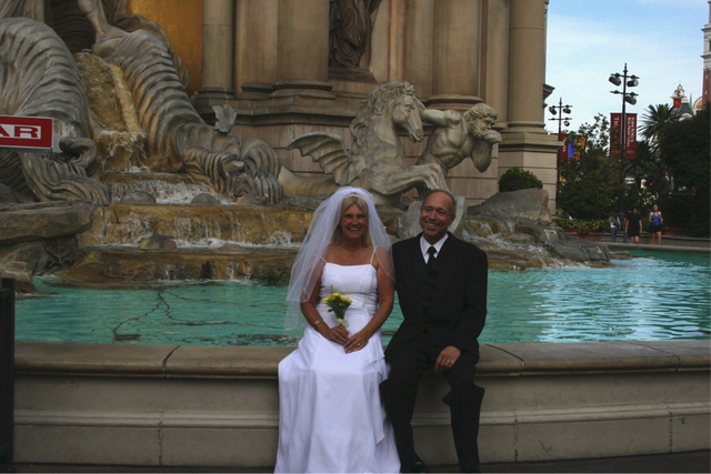 Newlyweds Sue Ellen Hogan and Glenn Franklin Jones pose in front of the Forum Shops at Caesars on Nov. 22, 2008. The two were married until they divorced in 2012. By then Hogan had already moved b ...