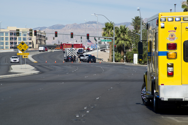 Police and firefighters investigate a suspicious package near Russell Road and the Interstate 15 in Las Vegas on Saturday, July 9, 2016. (Daniel Clark/Las Vegas Review-Journal Follow @DanJClarkPhoto)