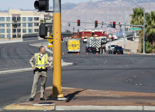 An officer blocks traffic as police and firefighters investigate a suspicious package near Russell Road and the Interstate 15 in Las Vegas on Saturday, July 9, 2016. (Daniel Clark/Las Vegas Review ...