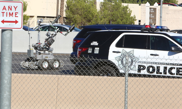 A bomb-sniffing robot is used as Metro police investigate a suspicious package on southbound Interstate 15 near the Hacienda overpass on Oct. 2, 2014. (Bizuayehu Tesfaye/Las Vegas Review-Journal F ...
