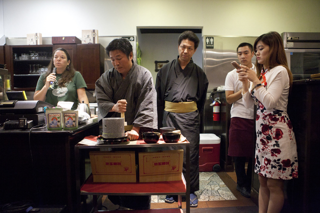 Eylse Petersen, from left, Mochitani Kunikazu and Yoshiaki Hattori participate in a demonstration while Dino Yi Geng, a waiter and Jing Li, owner watch at the tea tasting event at Niu-Gu Noodle Ho ...