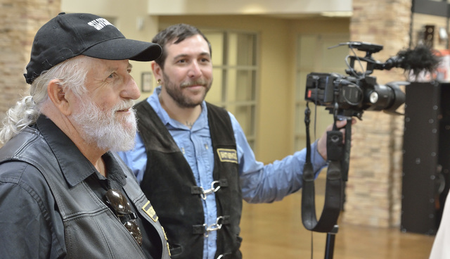 "Executive producer Greg Hirst, left, and cameraman and director Tim Robinson are shown during filming for ""Temporary Australians"" at Red Rock Harley Davidson at 2260 Rainbow Blvd. in ..."
