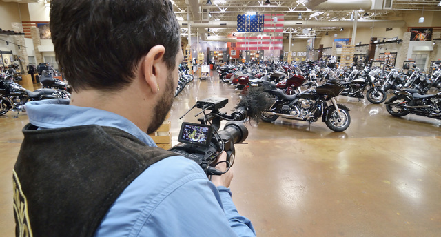 "Tim Robinson, director and cameraman for documentary and lifestyle TV show ""Temporary Australians,"" shoots in the showroom at Red Rock Harley Davidson at 2260 Rainbow Blvd. in La ..."
