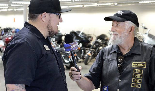 "Executive producer Greg Hirst, right, talks with service manager Matt Frost while filming the documentary and lifestyle TV show ""Temporary Australians"" at Red Rock Harley Davidso ..."