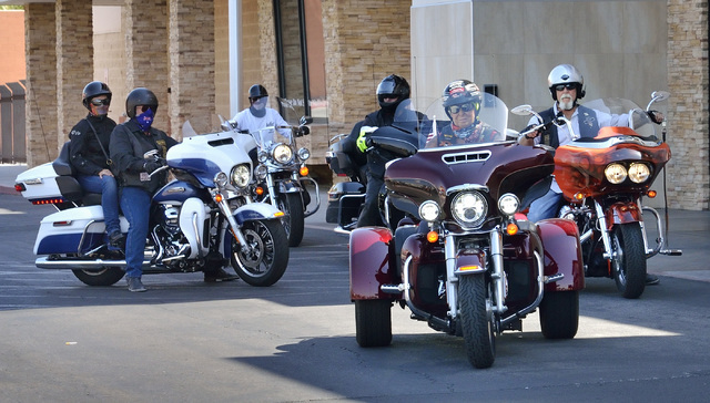 Las Vegans Cathy Gray, on bike in front, and Dan Jackson, right, lead a group of local and Australian motorcyclists out of the lot at Red Rock Harley Davidson at 2260 Rainbow Blvd. after a segment ...