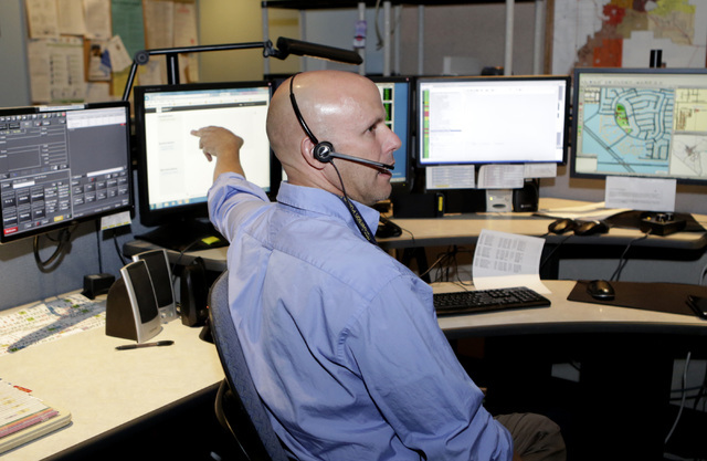 Henderson Police Communication Operator Jason Gacek talks about their 9-1-1 texting program during an interview at the HPD call center on Thursday, July 14, 2016. (Bizuayehu Tesfaye/Las Vegas Revi ...