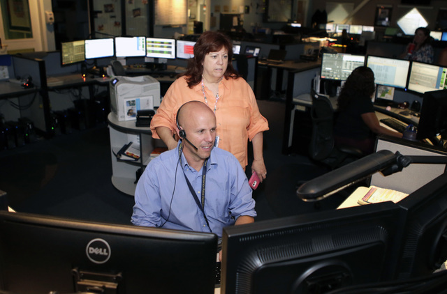 Henderson Police Communications Operator Jason Gacek monitors emergency calls and texts as Communications Center Administrator, Barbara Brabenec, right, looks on at the HPD call center on Thursday ...