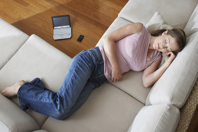 Woman napping on Couch (Thinkstock)