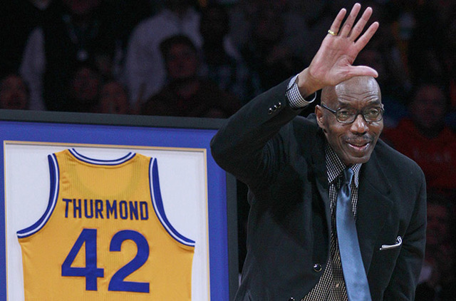 Former Golden State Warriors star Nate Thurmond waves during a halftime ceremony at a game in Oakland, Calif., in 2012. (Jeff Chiu/The Associated Press)