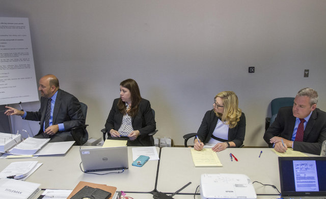 From left, Patrick Reilly and Nicole Lovelock, representing TitleMax, and Victoria Newman and Ted Helgesen, from TitleMax's parent company TMX Finance, during a preliminary hearing at the State of ...
