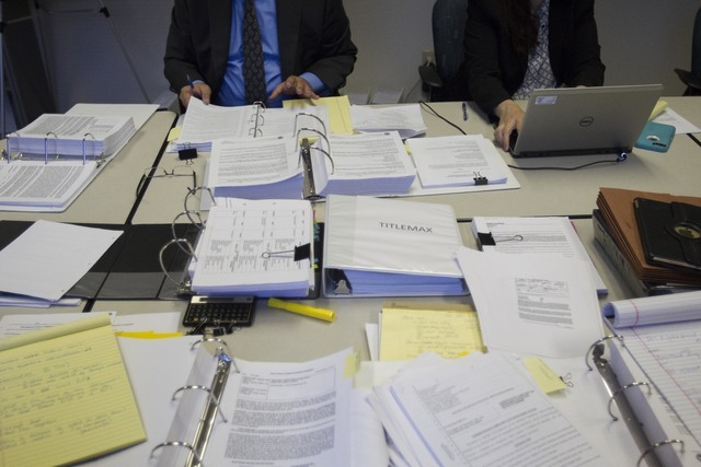 Paperwork and files are seen during a preliminary hearing at the State of Nevada Financial Institutions Division office in Las Vegas on Monday, July 18, 2016. Richard Brian/Las Vegas Review-Journa ...