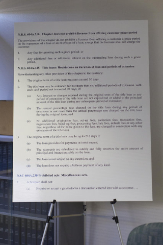 A enlarged print of N.R.S. 604A.210 is seen on display during a preliminary hearing at the State of Nevada Financial Institutions Division office located at 2785 Desert Inn Road in Las Vegas on Mo ...