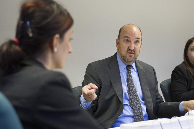 Attorney Patrick Reilly, right, representing TitleMax, questions Harveen Sekhon, left, supervisory examiner for Nevada's Financial Institutions Division, during a preliminary hearing at the State  ...