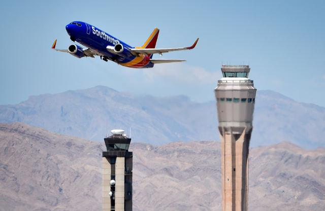A Southwest Airline passenger jet takes off from McCarran International Airport under the control of the smaller of the two federal air traffic control towers on Monday, June 8, 2015. David Becker ...