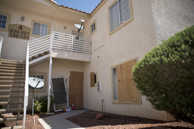 The apartment where Jason Dej-Oudom killed himself and his three children on Wednesday night is seen with boards across the windows and front door in Las Vegas on Friday, July 1, 2016. Dej-Oudom a ...