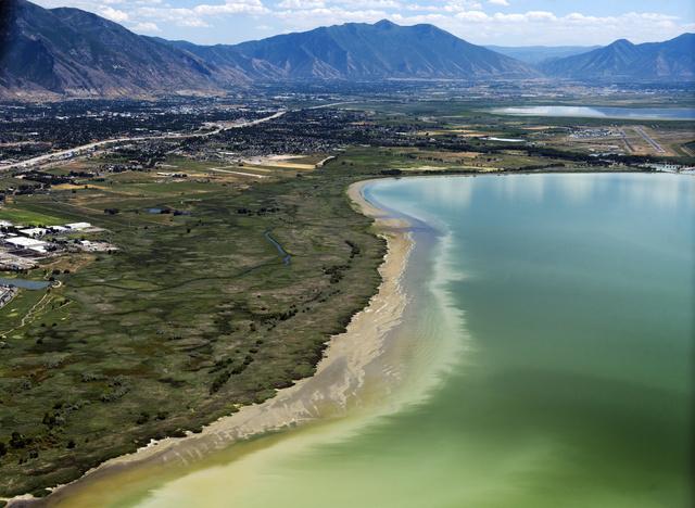 This July 14, 2016, photo shows discolored water caused by an algae bloom near the Lindon Marina in Utah Lake in Lindon, Utah. (Rick Egan/The Salt Lake Tribune via AP)