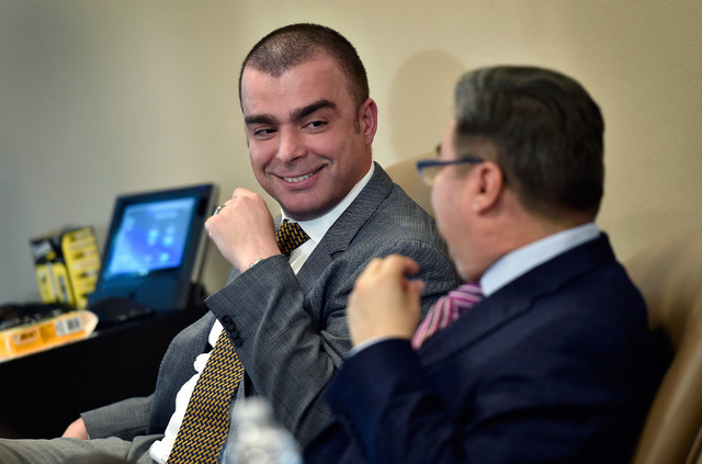 Drs. Fadi Braiteh, left, and James Sanchez chat during a monthly medical oncology division meeting at Comprehensive Cancer Centers offices Tuesday, April 12, 2016, in Henderson. Researchers in Nev ...
