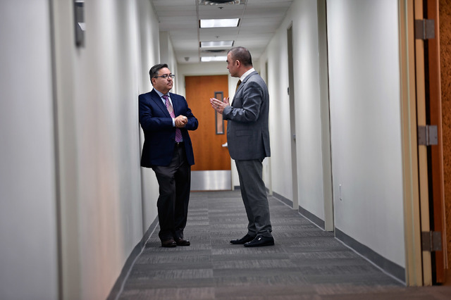 Drs. James Sanchez, left, and Fadi Braiteh chat before a monthly medical oncology division meeting at Comprehensive Cancer Centers offices Tuesday, April 12, 2016, in Henderson. Researchers in Nev ...