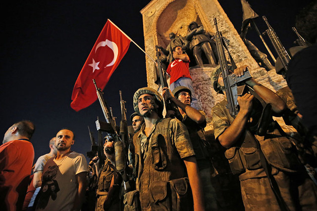 Turkish soldiers secure the area as supporters of Turkey's President Recep Tayyip Erdogan protest in Istanbul's Taksim square, early Saturday, July 16, 2016. (Emrah Gurel/The Associated Press)