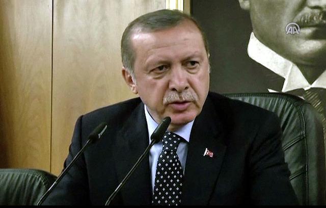 In this image taken from video provided by Anadolu Agency, Turkish President Recep Tayyip Erdogan speaks to the media Saturday, July 16, 2016 in Istanbul. (Anadolu Agency via AP)