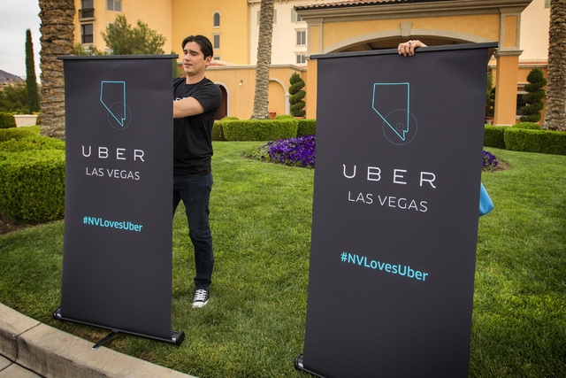Uber Kris Cuaresma-Primm removes signs after a press conference at the Hilton Lake Las Vegas Resort , 1610 Lake Las Vegas Pkwy, in Henderson on Wednesday, March 18,2015. (Jeff Scheid/Las Vegas Rev ...
