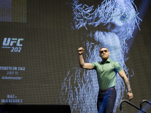 UFC featherweight champion Conor McGregor walks onto the stage during a press conference at T-Mobile Arena on Thursday, July 7, 2016, in Las Vegas, to promote his upcoming fight with Nate Diaz at  ...