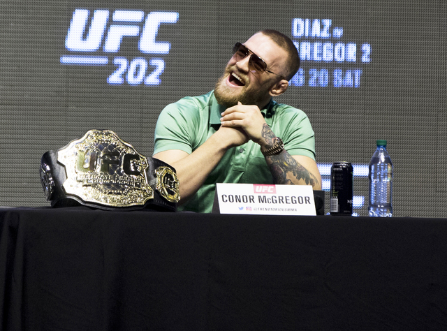 UFC featherweight champion Conor McGregor reacts to a question during a press conference at T-Mobile Arena on Thursday, July 7, 2016, in Las Vegas, to promote his upcoming fight with Nate Diaz at  ...