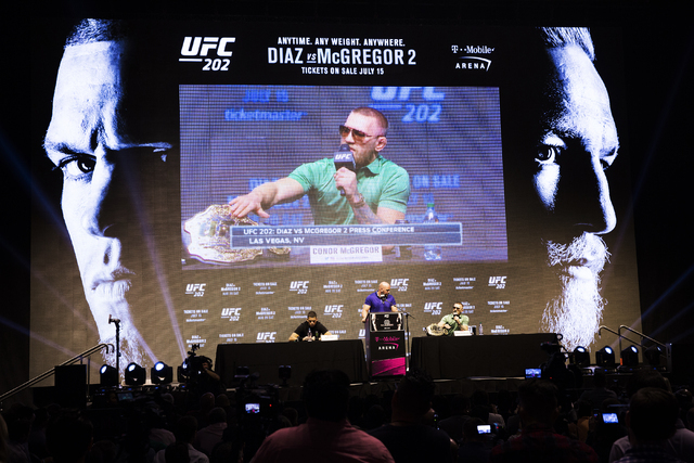 UFC featherweight champion Conor McGregor responds to a question during a press conference at T-Mobile Arena on Thursday, July 7, 2016, in Las Vegas, to promote his upcoming fight with Nate Diaz a ...