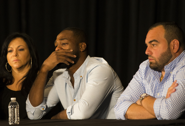 An emotional Jon Jones, middle, addresses questions about the cancellation of his light heavyweight fight with Daniel Cormier at UFC 200 during a press conference at the MGM Grand Garden Arena on  ...