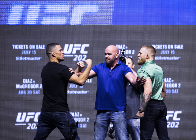 Nate Diaz, from left, UFC President Dana White and UFC featherweight champion Conor McGregor share a tense moment during a press conference at T-Mobile Arena on Thursday, July 7, 2016, in Las Vega ...