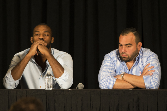 An emotional Jon Jones, left, addresses questions about the cancellation of his light heavyweight fight with Daniel Cormier at UFC 200 during a press conference at the MGM Grand Garden Arena on Th ...