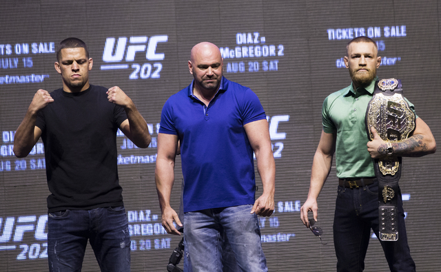 UFC lightweight contender Nate Diaz, from left, UFC President Dana White and UFC featherweight champion Conor McGregor pose for a photo during a press conference at T-Mobile Arena on Thursday, Jul ...
