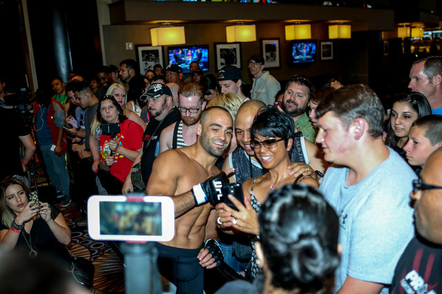 Eddie Alvarez poses with fans during a UFC open workout at the MGM Grand hotel-casino in Las Vegas on Tuesday, July. 5, 2016. (Elizabeth Brumley/Las Vegas Review-Journal) Follow @elipagephoto