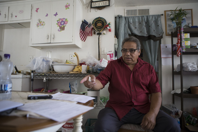 Jose Cruz Duran-Gonzalez speaks on a notice to vacate his apartment unless he agreed to a rent increase for his two-bedroom apartment at the University Park Apartments on Thursday, July 14, 2016,  ...