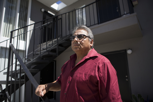 Jose Cruz Duran-Gonzalez poses in front of his two-bedroom apartment at the University Park Apartments on Thursday, July 14, 2016, in Las Vegas. Duran-Gonzalez received a notice to vacate unless h ...