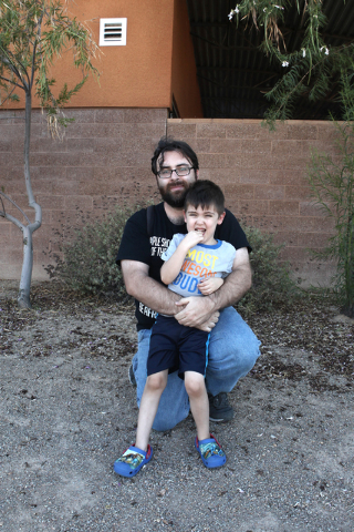 William Wolfs, 34, was inside UNLV's physics building Wednesday afternoon when the University of Nevada, Las Vegas police issued a false alarm about a person carrying a firearm on campus. His son  ...