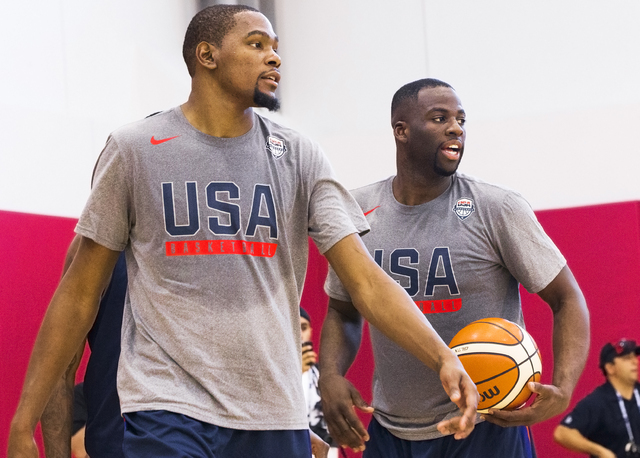 New Golden State Warriors teammates Kevin Durant, left, and Draymond Green participate in shooting drills during the first day of Team USA basketball practice at the Mendenhall Center at UNLV on M ...