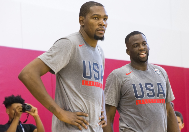 New Golden State Warriors teammates Kevin Durant, left, and Draymond Green work on post drills during the first day of Team USA basketball practice at the Mendenhall Center at UNLV on Monday, July ...