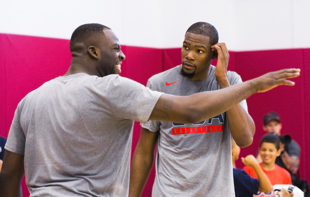 New Golden State Warriors teammates Draymond Green, left, and Kevin Durant interact during the first day of Team USA basketball practice at the Mendenhall Center at UNLV on Monday, July 18, 2016,  ...