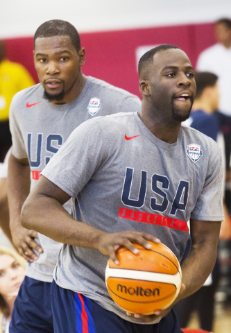New Golden State Warriors teammates Draymond Green, right, and Kevin Durant participate in shooting drills during the first day of Team USA basketball practice at the Mendenhall Center at UNLV on  ...