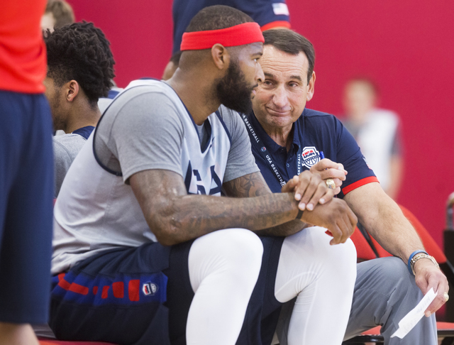 Head coach Mike Krzyzewski, right, talks with DeMarcus Cousins during the first day of Team USA basketball practice at the Mendenhall Center at UNLV on Monday, July 18, 2016, in Las Vegas. (Benjam ...