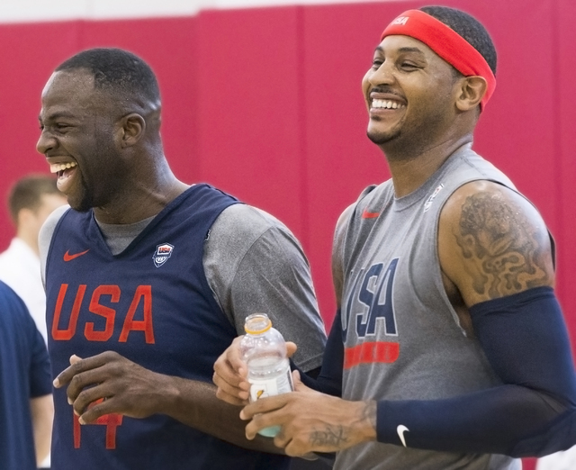 Draymond Green, left, and Carmelo Anthony share a moment during the first day of Team USA basketball practice at the Mendenhall Center at UNLV on Monday, July 18, 2016, in Las Vegas. (Benjamin Hag ...