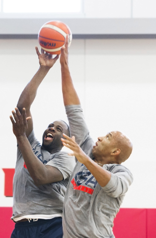Forward Draymond Green, left, drives to the basket over coach Monty Williams during the first day of Team USA basketball practice at the Mendenhall Center at UNLV on Monday, July 18, 2016, in Las  ...