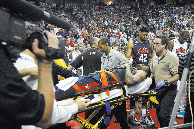 Indiana Pacer's Paul George is carted off the court after breaking his leg during the USA Basketball Showcase intrasquad game at the Thomas & Mack Center in Las Vegas on Friday, Aug. 1, 2014.  ...